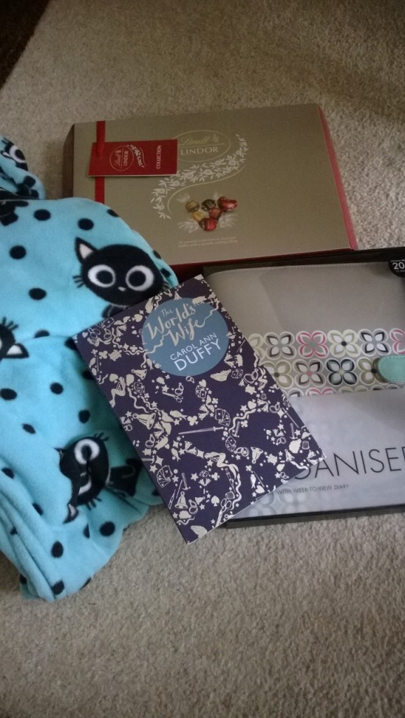 From James, some of my favourite chocolates, a Paperchase organiser, The World's Wife by Carol Ann Duffy and a cute cat onesie!
