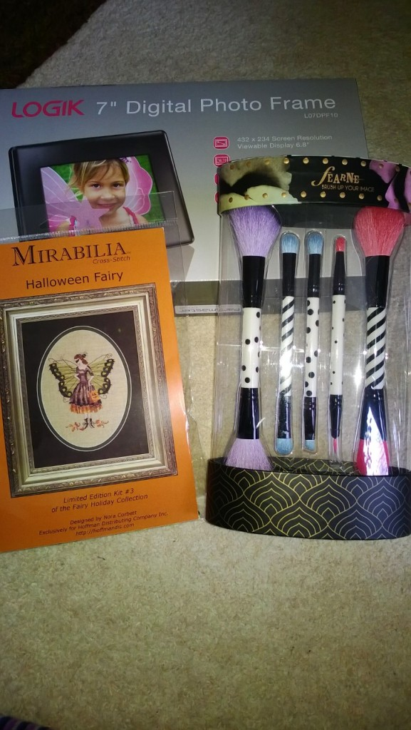 From my brother, a digital photo frame, and from my parents, a rather pretty make up brush set and a Nora Corbett cross stitch kit.